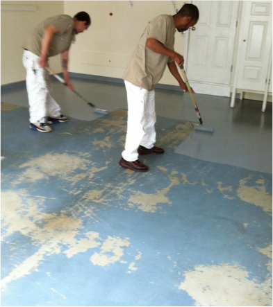workers painting floor