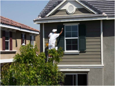 painter painting front of home